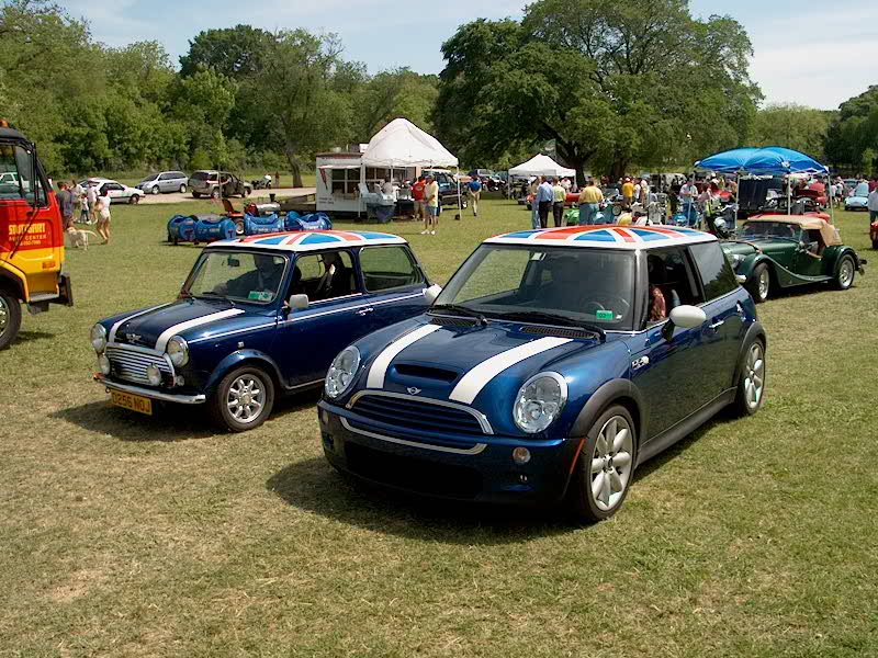 An old classic Mini Cooper alongside a 2014 BMW MINI Cooper