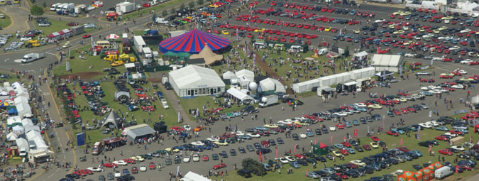 Photo of classic car show from the air